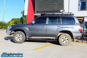 "Left side view of a Silver Toyota 100 Series Landcruiser after fitment of a 2"" Inch Lift Kit with Airbags"