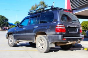 """Rear left view of a Silver Toyota 100 Series Landcruiser after fitment of a 2"""" Inch Lift Kit with Airbags"""