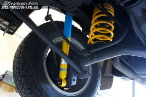 Rear right underbody guard view of the fitted Bilstein Front Shock + King Coil Spring