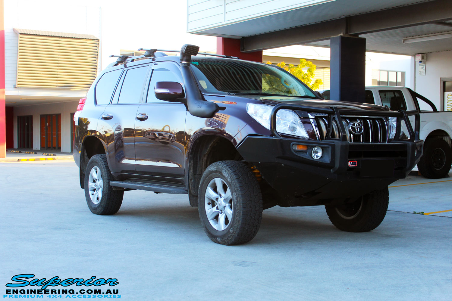 """Right front side view of a Toyota 150 Series Prado Wagon after fitment of quality King Coil Springs & Bilstein 2"""" Inch Struts & Shocks"""