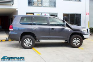 Right side view of a Grey Toyota 200 Series Landcruiser Wagon being fitted with a Brown Davis Long Range Fuel Tank @ Superior