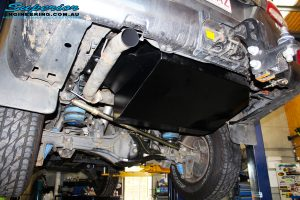 Rear left underbody view of a fitted Brown Davis Long Range Fuel Tank on this 200 Series Landcruiser