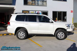 Right side view of a Toyota 200 Series Cruiser Wagon in White being fitted with Superior Chromoly Upper Control Arms