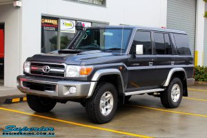 """Left front side view of a Grey Toyota 76 Series Landcruiser before fitment of a Superior 5"""" Inch Remote Reservoir Superflex Lift Kit"""