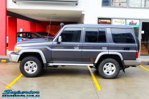 """Left side view of a Grey Toyota 76 Series Landcruiser before fitment of a Superior 5"""" Inch Remote Reservoir Superflex Lift Kit"""