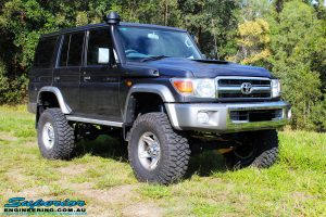 """Front right side view of a Grey Toyota 76 Series Landcruiser after fitment of a Superior 5"""" Inch Remote Reservoir Superflex Lift Kit"""