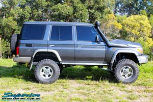 "Right side view of a Grey Toyota 76 Series Landcruiser after fitment of a Superior 5"" Inch Remote Reservoir Superflex Lift Kit"