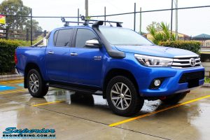 """Right front side view of a Toyota Revo Hilux Dual Cab in Blue before fitment of a EZY Lift 45mm Lift Kit with Superior 2"""" Inch Nitro Gas Rear Shocks"""