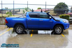 """Right side view of a Toyota Revo Hilux Dual Cab in Blue before fitment of a EZY Lift 45mm Lift Kit with Superior 2"""" Inch Nitro Gas Rear Shocks"""