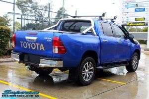 "Rear right view of a Toyota Revo Hilux Dual Cab in Blue before fitment of a EZY Lift 45mm Lift Kit with Superior 2"" Inch Nitro Gas Rear Shocks"