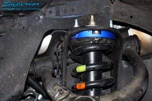 Front left close up inside guard view of the fitted EZY Lift 45mm Strut Spacer