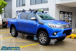 "Right front side view of a Toyota Revo Hilux Dual Cab in Blue after fitment of a EZY Lift 45mm Lift Kit with Superior 2"" Inch Nitro Gas Rear Shocks"