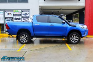 "Right side view of a Toyota Revo Hilux Dual Cab in Blue after fitment of a EZY Lift 45mm Lift Kit with Superior 2"" Inch Nitro Gas Rear Shocks"