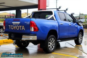 "Rear right view of a Toyota Revo Hilux Dual Cab in Blue after fitment of a EZY Lift 45mm Lift Kit with Superior 2"" Inch Nitro Gas Rear Shocks"