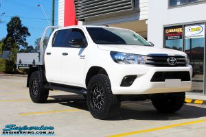 Right front side view of a Toyota Revo Hilux Dual Cab before fitment of Superior Upper Control Arms & a Diff Drop Kit