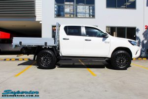 Right side view of a Toyota Revo Hilux Dual Cab before fitment of Superior Upper Control Arms & a Diff Drop Kit