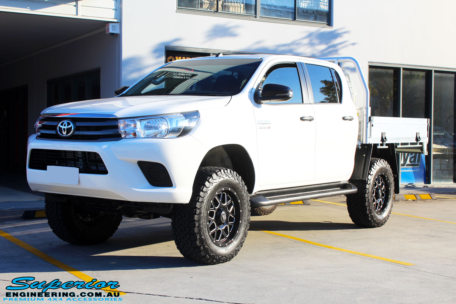 Left front side view of a Toyota Revo Hilux Dual Cab after fitment of Superior Upper Control Arms & a Diff Drop Kit