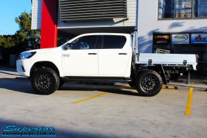 Left side view of a Toyota Revo Hilux Dual Cab after fitment of Superior Upper Control Arms & a Diff Drop Kit
