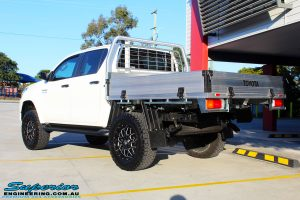 Rear left view of a Toyota Revo Hilux Dual Cab after fitment of Superior Upper Control Arms & a Diff Drop Kit