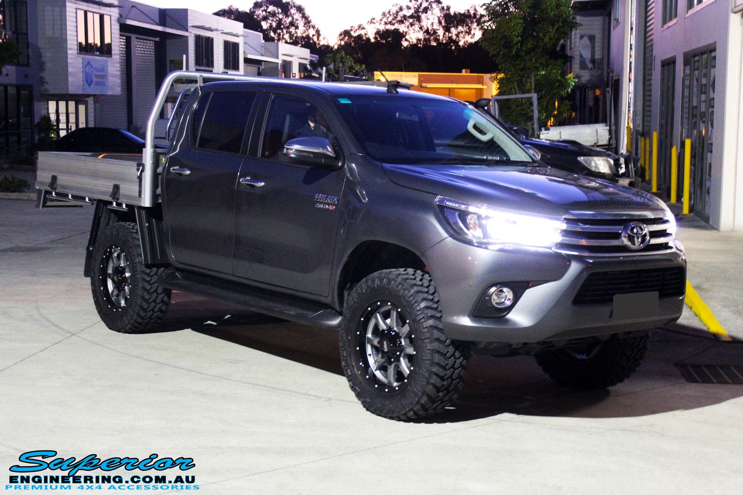 "Right front side view of a Toyota Revo Hilux Dual Cab in Grey after fitment of a Fox 2.0 Performance Series IFP 2"" Inch Lift Kit + Upper Control Arms"