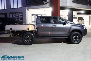"""Right side view of a Toyota Revo Hilux Dual Cab in Grey after fitment of a Fox 2.0 Performance Series IFP 2"""" Inch Lift Kit + Upper Control Arms"""