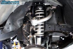 Front left close up inside guard view of the fitted Front Fox 2.0 Performance Series IFP Strut + Upper Control Arm