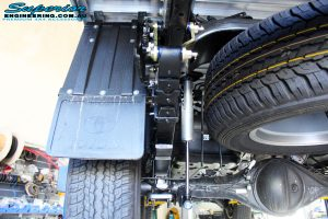 Rear left underbody view of the fitted Rear Fox 2.0 Performance Series IFP Shocks, Leaf Springs with U-Bolt Kit and Shackles