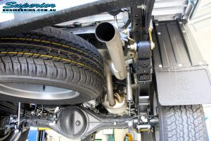 Rear right underbody view of the fitted Rear Fox 2.0 Performance Series IFP Shocks, Leaf Springs with U-Bolt Kit and Shackles