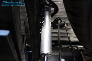 Rear close up left underbody view of the fitted Fox 2.0 Performance Series IFP Shock