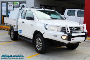 """Right front side view of a Toyota Revo Hilux Xtra Cab in White before fitment of a EFS 2"""" Inch Lift Kit"""