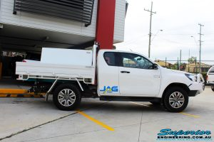 """Right side view of a Toyota Revo Hilux Xtra Cab in White before fitment of a EFS 2"""" Inch Lift Kit"""