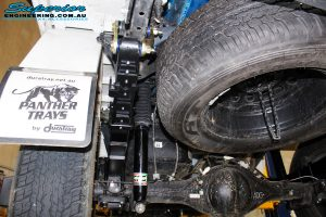 """Rear left underbody view of the fitted fitted EFS Enforcer 2"""" Shocks with Leaf Springs & Greaseable Rear Shackle"""
