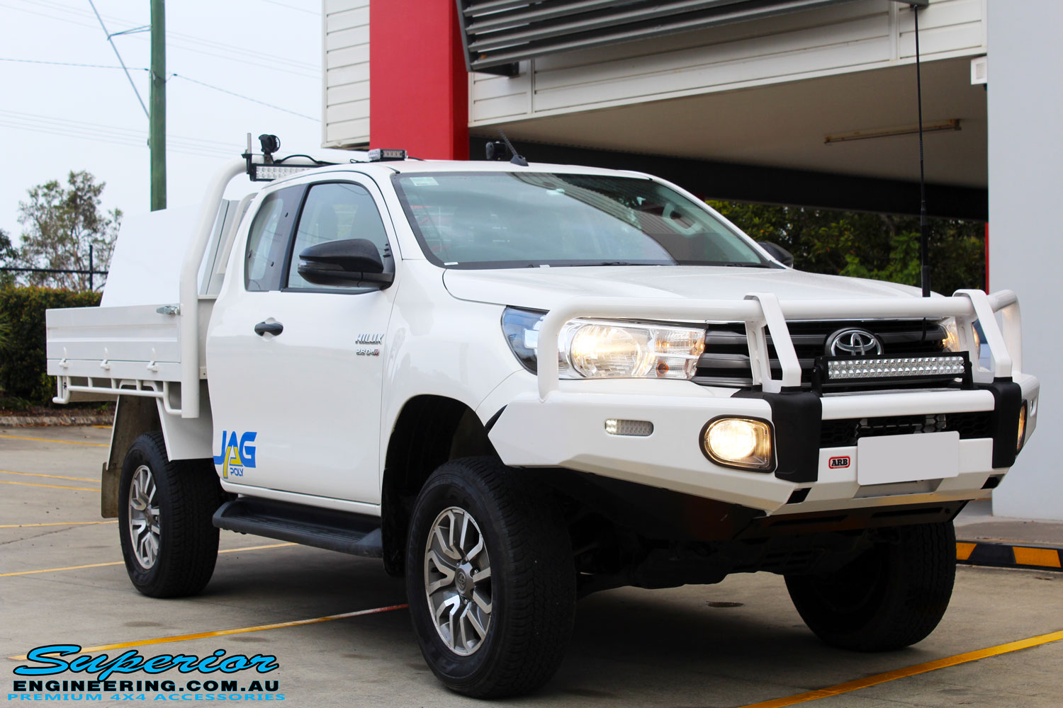 "Right front side view of a Toyota Revo Hilux Xtra Cab in White after fitment of a EFS 2"" Inch Lift Kit"