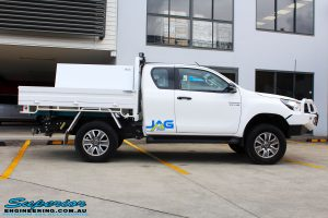 """Right side view of a Toyota Revo Hilux Xtra Cab in White after fitment of a EFS 2"""" Inch Lift Kit"""