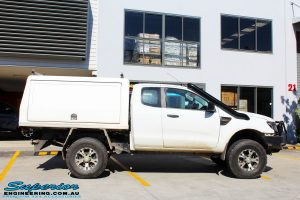 """Right side view of a Ford PX Ranger in White before fitment of a Superior 4"""" Inch Remote Reservoir Lift Kit"""