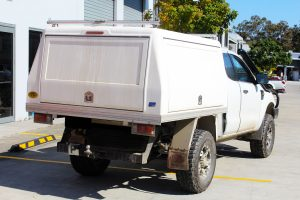 """Rear right view of a Ford PX Ranger in White before fitment of a Superior 4"""" Inch Remote Reservoir Lift Kit"""