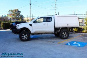 """Left side view of a Ford PX Ranger in White after fitment of a Superior 2"""" Inch Remote Reservoir Lift Kit"""