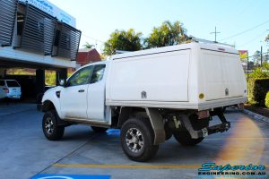"""Rear left view of a Ford PX Ranger in White after fitment of a Superior 2"""" Inch Remote Reservoir Lift Kit"""