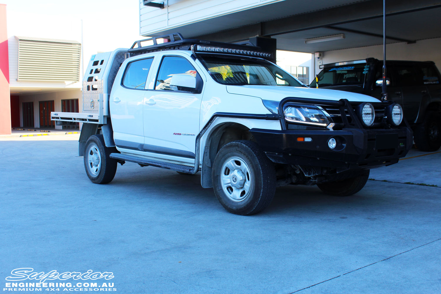 """Right front side view of a White Holden RG Colorado Dual Cab after fitment of a Superior Remote Reservoir 2"""" Inch Lift Kit"""