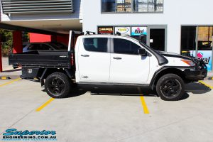 Right mid side view of a Mazda BT-50 in White On The Hoist @ Superior Engineering Deception Bay Showroom