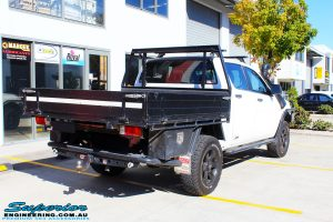 Rear right view of a Mazda BT-50 in White On The Hoist @ Superior Engineering Deception Bay Showroom
