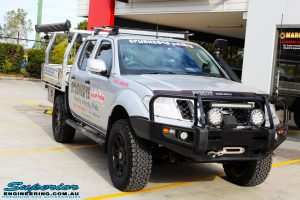 Right front side view of a Nissan D40 Navara Dual Cab in Silver before fitment of Dobinson 40mm Front Coil Springs