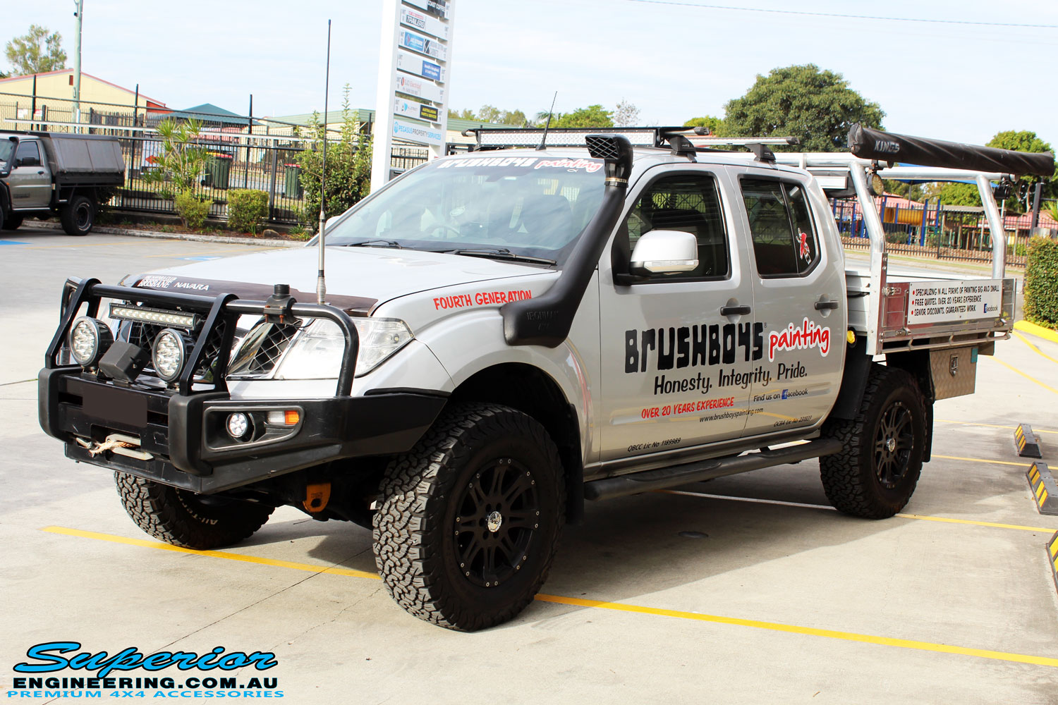 Left front side view of a Nissan D40 Navara Dual Cab in Silver after fitment of Dobinson 40mm Front Coil Springs