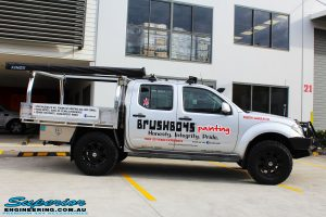 Right side view of a Nissan D40 Navara Dual Cab in Silver after fitment of Dobinson 40mm Front Coil Springs
