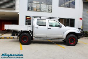 Right side view of a Nissan D40 Navara in Silver On The Hoist @ Superior being fitted with a Chassis Brace/Repair Plate
