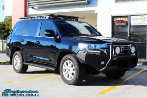 Right front side view of a Toyota 200 Series Landcruiser Wagon in Black before fitment of a Ironman 4x4 50mm Lift Kit with Superior Diff Drop Kit