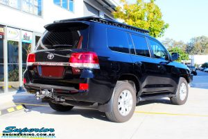 Rear right view of a Toyota 200 Series Landcruiser Wagon in Black before fitment of a Ironman 4x4 50mm Lift Kit with Superior Diff Drop Kit
