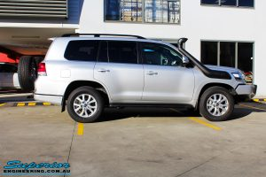 """Right side view of a Silver Toyota 200 Series Landcruiser before fitment of a Superior Remote Reservoir 2"""" Inch Lift Kit"""