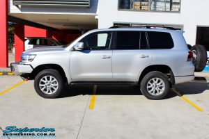 """Left side view of a Silver Toyota 200 Series Landcruiser after fitment of a Superior Remote Reservoir 2"""" Inch Lift Kit"""