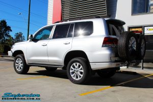 """Left rear side view of a Silver Toyota 200 Series Landcruiser after fitment of a Superior Remote Reservoir 2"""" Inch Lift Kit"""